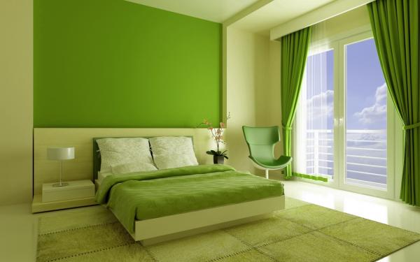 Стеля і стіни в спальні пофарбовані в ніжний зелений колір